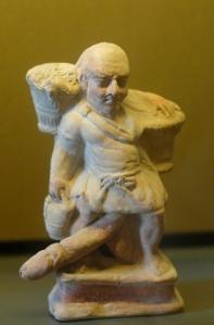 Ithyphallic_slave_Louvre_Myr332